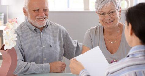 Senior couple at financial advisor smiling