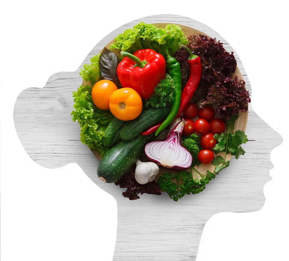 Fresh vegetables in woman head symbolizing health nutrition